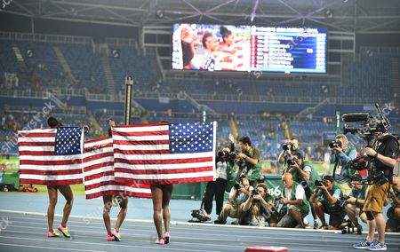 Brianna Rollins (c) of the Usa Celebrates After Winning the Women's 100m Hurdles Final of the Rio 2016 Olympic Games Athletics Track and Field Events at the Olympic Stadium in Rio De Janeiro Brazil 17 August 2016 Rollins Won Ahead of Her Compatriots Second Placed Nia Ali (r) and Third Placed Kristi Castlin (l) Brazil Rio De Janeiro