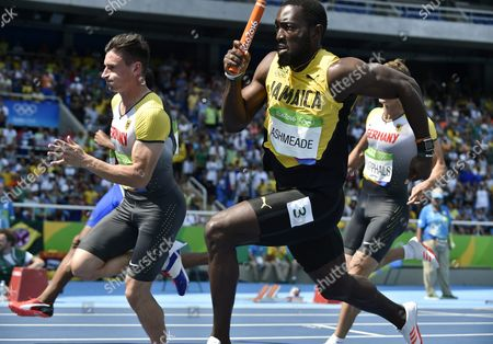 Stock Picture of Nickel Ashmeade (r) of Jamaica and Robert Hering of Germany in Action During the Men's 4x100m Heats of the Rio 2016 Olympic Games Athletics Track and Field Events at the Olympic Stadium in Rio De Janeiro Brazil 18 August 2016 Brazil Rio De Janeiro