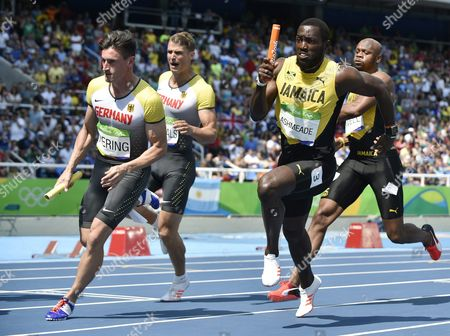 Nickel Ashmeade (r) of Jamaica and Robert Hering of Germany in Action During the Men's 4x100m Heats of the Rio 2016 Olympic Games Athletics Track and Field Events at the Olympic Stadium in Rio De Janeiro Brazil 18 August 2016 Brazil Rio De Janeiro