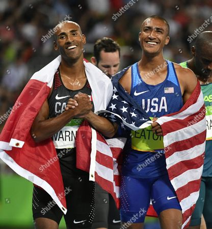 Ashton Eaton of the Usa (r) and Damian Warner of Canada (l) Celebrates After Running the Men's Decathlon 1500m Race in the Decathlon of the Rio 2016 Olympic Games Athletics Track and Field Events at the Olympic Stadium in Rio De Janeiro Brazil 18 August 2016 Eaton Won the Gold Medal and Warner Won the Bronze Medal Brazil Rio De Janeiro