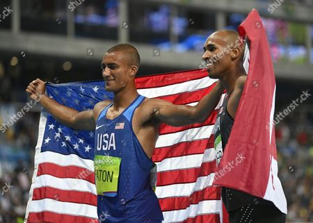 Ashton Eaton of the Usa (l) and Damian Warner of Canada (r) Celebrates After Running the Men's Decathlon 1500m Race in the Decathlon of the Rio 2016 Olympic Games Athletics Track and Field Events at the Olympic Stadium in Rio De Janeiro Brazil 18 August 2016 Eaton Won the Gold Medal and Warner Won the Bronze Medal Brazil Rio De Janeiro