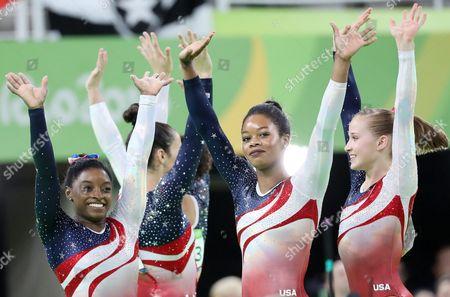 Simone Biles (l) Gabrielle Douglas (c) Madison Kocian (r) and Teammates of the Usa Celebrate After Winning the Women's Team Final of the Rio 2016 Olympic Games Artistic Gymnastics Events at the Rio Olympic Arena in Barra Da Tijuca Rio De Janeiro Brazil 09 August 2016 Brazil Rio De Janeiro