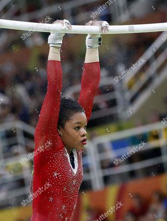 Gabrielle Douglas of Usa Performs During the Women's Uneven Bars Final Individual Competition of the Rio 2016 Olympic Games Artistic Gymnastics Events at the Rio Olympic Arena in Barra Da Tijuca Rio De Janeiro Brazil 14 August 2016 Brazil Rio De Janeiro