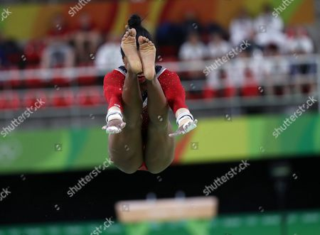 Stock Photo of Gabrielle Douglas of Usa Performs During the Women's Uneven Bars Final Individual Competition of the Rio 2016 Olympic Games Artistic Gymnastics Events at the Rio Olympic Arena in Barra Da Tijuca Rio De Janeiro Brazil 14 August 2016 Brazil Rio De Janeiro