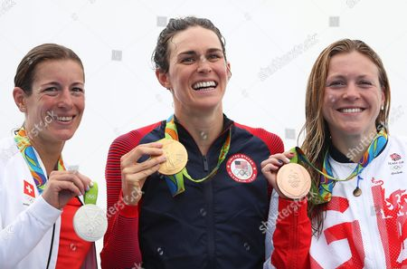 Gwen Jorgensen (c) of the Usa Poses with Her Gold Medal in Front of the Olympic Rings After Winning the Women's Triathlon Race of the Rio 2016 Olympic Games at Fort Copacabana in Rio De Janeiro Brazil 20 August 2016 Jorgensen Won Ahead of Second Placed Nicola Spirig (l) of Switzerland and Third Placed Vicky Holland (r) of Britain Brazil Rio De Janeiro