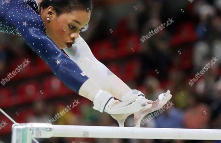 Gabrielle Douglas of the Usa Competes on the Uneven Bars During the Women's Team Final of the Rio 2016 Olympic Games Artistic Gymnastics Events at the Rio Olympic Arena in Barra Da Tijuca Rio De Janeiro Brazil 09 August 2016 Brazil Rio De Janeiro