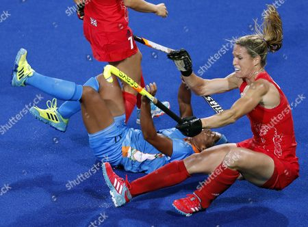 Georgie Twigg (l) and Susannah Townsend (r) of Great Britain and Deepika Deepika of India (c) Vie For the Ball During the Women's Pool B Field Hockey Game Between India and Great Britain of the Rio 2016 Olympic Games at the Olympic Hockey Centre in Rio De Janeiro Brazil 08 August 2016 Brazil Rio De Janeiro