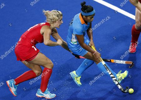 Georgie Twigg of Great Britain (l) and Deepika Deepika of India (r) Vie For the Ball During the Women's Pool B Field Hockey Game Between India and Great Britain of the Rio 2016 Olympic Games at the Olympic Hockey Centre in Rio De Janeiro Brazil 08 August 2016 Brazil Rio De Janeiro