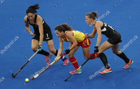Spain's Georgina Oliva (c) and New Zealand's Kayla Whitelock (l) and Petrea Webster (r) in Action During Their Rio 2016 Olympic Games Women's Field Hockey Match at the Olympic Hockey Centre in Rio De Janeiro Brazil 10 August 2016 Brazil Rio De Janeiro