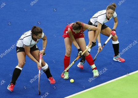 Stock Image of South Korea's Hye Lyoung Han (c) and Germany's Julia Muller (l) and Lisa Schutze (r) in Action During Their Rio 2016 Olympic Games Women's Field Hockey Match at the Olympic Hockey Centre in Rio De Janeiro Brazil 10 August 2016 E Brazil Rio De Janeiro
