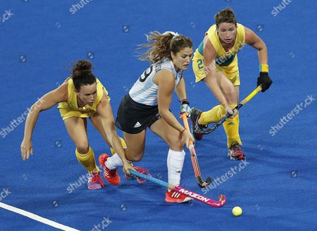 Argentina's Julia Gomes (c) and Australia's Georgie Parker (l) and Kathryn Slattery (r) During Their Rio 2016 Olympic Games Women's Field Hockey Match at the Olympic Hockey Centre in Rio De Janeiro Brazil 11 August 2016 Brazil Rio De Janeiro