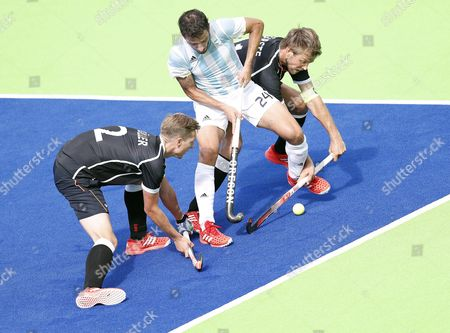 Germany's Matthias Muller (l) and Moritz Furste (r) Trap Argentina's Manuel Brunet (c) During the Men's Field Hockey Game of the Rio 2016 Olympic Games at the Olympic Hockey Centre in Rio De Janeiro Brazil 11 August 2016 Brazil Rio De Janeiro