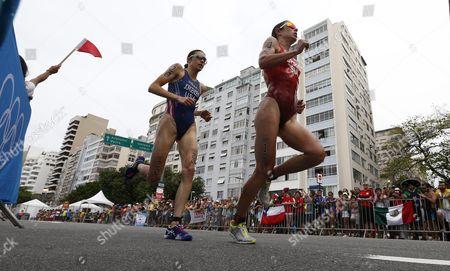 Gwen Jorgensen of the United States (l) Runs Along Behind Nicola Spirig Hug of Switzerland (r) in the Women's Triathlon at Fort Copacabana in Rio De Janeiro Brazil 20 August 2016 Brazil Rio De Janeiro