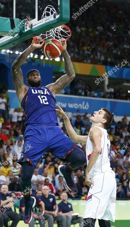 Usa's Demarcus Cousins (l) Dunks in Front of Serbia's Nikola Jokic (r) During Their Rio 2016 Olympic Games Men's Gold Medal Game at the Carioca Arena 1 in the Olympic Park in Rio De Janeiro Brazil 21 August 2016 Brazil Rio De Janeiro