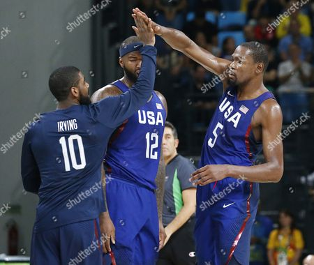 Stock Image of Usa's (l-r) Kyrie Irving Demarcus Cousins and Kevin Durant React As They Play Serbia During Their Rio 2016 Olympic Games Men's Gold Medal Game at the Carioca Arena 1 in the Olympic Park in Rio De Janeiro Brazil 21 August 2016 Brazil Rio De Janeiro