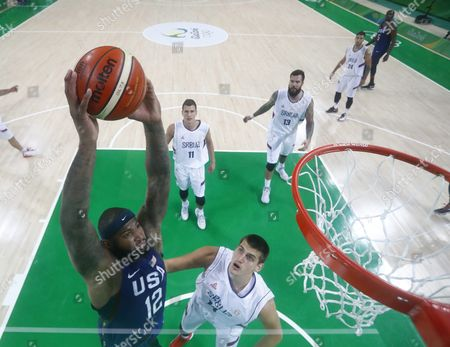 Stock Photo of Demarcus Cousins of the Usa (l) Goes Up For a Slam As Nikola Jokic of Serbia (c) Looks on During the Men's Gold Medal Basketball Game of the Rio 2016 Olympic Games at the Carioca Arena 1 in the Olympic Park in Rio De Janeiro Brazil 21 August 2016 Brazil Rio De Janeiro