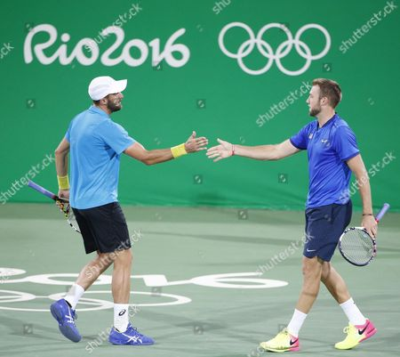 Steve Johnson (l) and Jack Sock (r) of the Us React As They Play Daniel Nestor and Vasek Popisil of Canada During Their Rio 2016 Olympic Games Men's Doubles Match at the Olympic Tennis Centre in the Olympic Park in Rio De Janeiro Brazil 12 August 2016 Brazil Rio De Janeiro