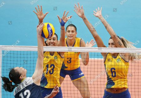 Hui Ruoqi of China (l) Spikes the Ball Against Brazil's Block (l-r) Natalia Danielle and Thaisa During the Women's Quarterfinals Volleyball Match of the Rio 2016 Olympic Games Between Brazil and China at Maracanazinho Indoor Arena in Rio De Janeiro Brazil 16 August 2016 Brazil Rio De Janeiro