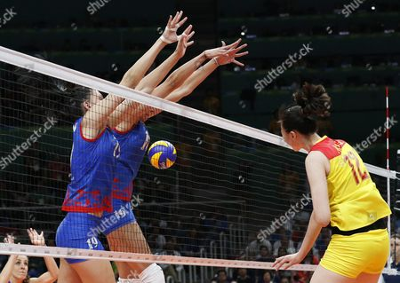 China's Ruoqi Hui (r) Spikes the Ball During the Women's Volleyball Gold Medal Match Between China and Serbia of the Rio 2016 Olympic Games at Maracanazinho Indoor Arena in Rio De Janeiro Brazil 20 August 2016 Brazil Rio De Janeiro