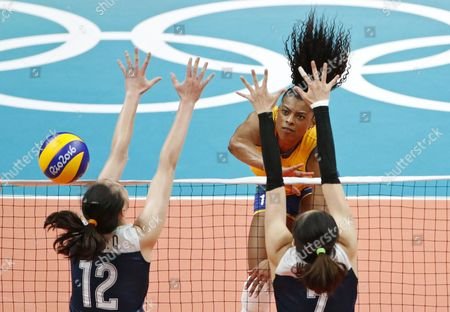 Fernanda of Brazil (c) Spikes the Ball Against China's Block Hui Ruoqi (l) and Wei Qiuyue (r) During the Women's Quarterfinals Volleyball Match of the Rio 2016 Olympic Games Between Brazil and China at Maracanazinho Indoor Arena in Rio De Janeiro Brazil 16 August 2016 Brazil Rio De Janeiro