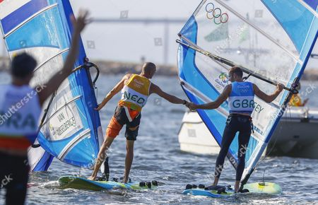 Dorian Van Rysselberghe (l) of the Netherlands is Congratulated by Second Placed Nick Dempsey (r) of Britain After Winning the Gold Medal in the Men's Rs:x Class Race of the Rio 2016 Olympic Games Sailing Events in Rio De Janeiro Brazil 14 August 2016 Brazil Rio De Janeiro