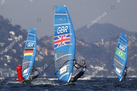Nick Dempsey (c) of Britain Sails on His Way to Win the Silver Medal in the Men's Rs:x Class Race of the Rio 2016 Olympic Games Sailing Events in Rio De Janeiro Brazil 14 August 2016 Brazil Rio De Janeiro