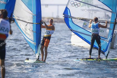 Dorian Van Rysselberghe (l) of the Netherlands Reacts Next to Second Placed Nick Dempsey (r) of Britain After Winning the Gold Medal in the Men's Rs:x Class Race of the Rio 2016 Olympic Games Sailing Events in Rio De Janeiro Brazil 14 August 2016 Brazil Rio De Janeiro