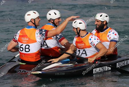 Richard Hounslow (l-r) and David Florence of Great Britain Cheer with Gauthier Klauss and Matthieu Peche of France After the Men's Canoe Double (c2) Final Race of the Rio 2016 Olympic Games Canoe Slalom Events at the Whitewater Stadium in Rio De Janeiro Brazil 11 August 2016 Brazil Rio De Janeiro