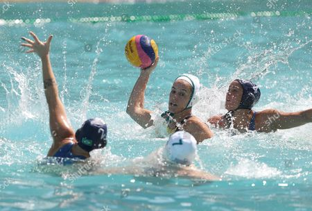 Rowie Webster of Australia (c) in Action Against Diana Abla of Brazil (l) and Marina Canetti of Brazil (r) During the Women's Water Polo Game of the Rio 2016 Olympic Games at the Maria Lenk Aquatics Centre in the Olympic Park in Rio De Janeiro Brazil 13 August 2016 Brazil Rio De Janeiro