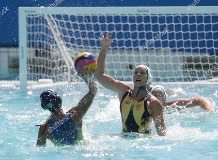 Stock Image of Amanda Oliveira of Brazil (l) in Action Against Nicola Zagame of Australia (r) During the Women's Water Polo Game of the Rio 2016 Olympic Games at the Maria Lenk Aquatics Centre in the Olympic Park in Rio De Janeiro Brazil 13 August 2016 Brazil Rio De Janeiro