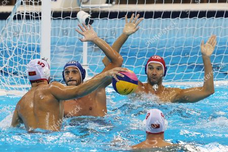 Darko Brguljan (l) of Montenegro in Action Against Valentino Gallo (2-l) of Italy During Men's Bronze Medal Match of the Rio 2016 Olympic Games at the Olympic Aquatics Stadium in the Olympic Park in Rio De Janeiro Brazil 20 August 2016 Brazil Rio De Janeiro