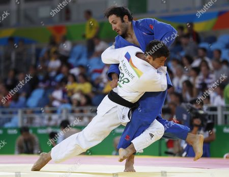 Ashley Mckenzie of Great Britain (l) and Bekir Ozlu of Turkey (r) in Action in the Men's 60kg Bout of the Rio 2016 Olympic Games Judo Events at the Carioca Arena 2 in the Olympic Park in Rio De Janeiro Brazil 06 August 2016 Brazil Rio De Janeiro