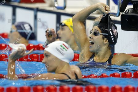 Maya Dirado of Usa (r) Celebrates Winning the Women's 200m Backstroke Final Race of the Rio 2016 Olympic Games Swimming Events at Olympic Aquatics Stadium at the Olympic Park in Rio De Janeiro Brazil 12 August 2016 Brazil Rio De Janeiro