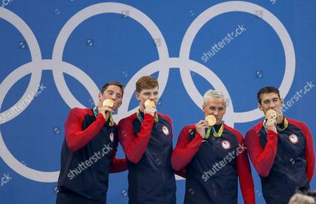 (l-r) Conor Dwyer Townley Haas Ryan Lochte and Michael Phelps of the Us Pose with Ther Gold Medals on the Podium During the Medal Ceremony For the Men's 4x200m Freestyle Relay Final of the Rio 2016 Olympic Games Swimming Events at Olympic Aquatics Stadium at the Olympic Park in Rio De Janeiro Brazil 09 August 2016 Brazil Rio De Janeiro