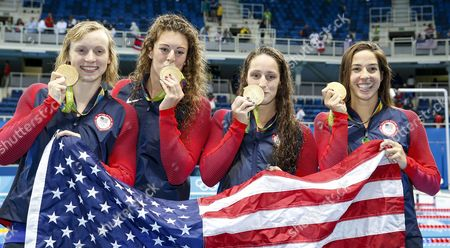Usa Swimmers Katie Ledecky (l-r) Allison Schmitt Leah Smith and Maya Dirado Pose During the Round of Honour After the Medal Ceremony For the Women's 4x200m Freestyle Relay Final Race of the Rio 2016 Olympic Games Swimming Events at Olympic Aquatics Stadium at the Olympic Park in Rio De Janeiro Brazil 10 August 2016 Brazil Rio De Janeiro