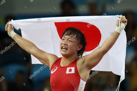 Eri Tosaka of Japan Celebrates After Winning the Wrestle Against Mariya Stadnik of Azerbaijan During the Women's Freestyle 48kg Gold Medal Game of the Rio 2016 Olympic Games Wrestling Events at the Carioca Arena 2 in the Olympic Park in Rio De Janeiro Brazil 17 August 2016 Brazil Rio De Janeiro
