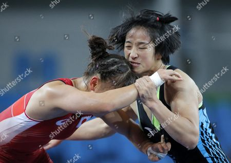 Eri Tosaka (red) of Japan in Action Against Yanan Sun (blue) of China in the Women's Freestyle 48kg Semifinal Match of the Rio 2016 Olympic Games Wrestling Events at the Carioca Arena 2 in the Olympic Park in Rio De Janeiro Brazil 17 August 2016 Brazil Rio De Janeiro
