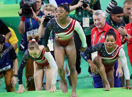 (from Left) Madison Kocian Simone Biles and Gabrielle Douglas of the Usa Celebrate After Winning the Women's Team Final of the Rio 2016 Olympic Games Artistic Gymnastics Events at the Rio Olympic Arena in Barra Da Tijuca Rio De Janeiro Brazil 09 August 2016 Brazil Rio De Janeiro