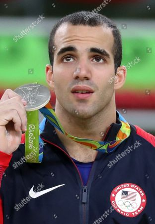 Silver Medalist Danell Leyva of the Usa Poses During the Award Ceremony of the Men's Horizontal Bar Final For the Rio 2016 Olympic Games Artistic Gymnastics Events at the Rio Olympic Arena in Barra Da Tijuca Rio De Janeiro Brazil 16 August 2016 Brazil Rio De Janeiro