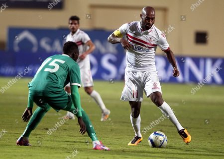 Zamalek's Shikabala (r) in Action Against Douala's Olivier (l) During the Caf Champions League First Qualifying Round Second Leg Soccer Match Between Zamalek Sc and Us Douala at Petro Sport Stadium in Cairo Egypt 19 March 2016 Egypt Cairo