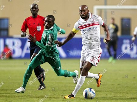 Zamalek's Shikabala (r) in Action Against Douala's Kady Fabril (c) During the Caf Champions League First Qualifying Round Second Leg Soccer Match Between Zamalek Sc and Us Douala at Petro Sport Stadium in Cairo Egypt 19 March 2016 Egypt Cairo