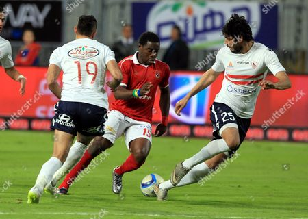 Al-zamalek Player Ahmed Dewdar (l) and Ali Gabr (r) Fights For the Ball with Al-ahly Player Evona (c) During Their Egyptian League Soccer Soccer Match at Borg El Arab Narmy Stadium in Alexandria Egypt 9 February 2016 the Match Between the Two Cairo Clubs is Held in Alexandria Due to Security Reasons Egypt Alexandria