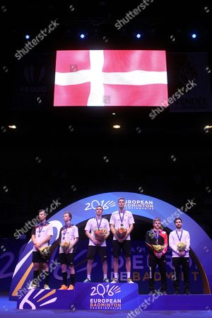 Mads Conrad-petersen and Mads Pieler Kolding of Denmark Celebrate on the Podium After Their Victory in the Men Double Final Match Against Kim Astrup and Anders Skaarup Rasmussen of Denmark at the Badminton European Championships in La Roche Sur Yon France 1 May 2016 France La Roche Sur Yon