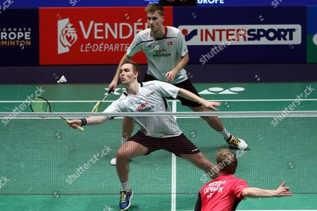 Mads Conrad-petersen and Mads Pieler Kolding of Denmark in Action Against Kim Astrup and Anders Skaarup Rasmussen of Denmark During Their Men Double Final Match at the Badminton European Championships in La Roche Sur Yon France 1 May 2016 France La Roche Sur Yon