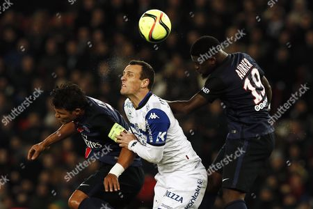 Sebastien Squillaci of Sc Bastia (c) in Action Against Thiago Silva (l) and Serge Aurier of Paris St Germain During the French League 1 Soccer Match Paris Saint Germain Vs Sc Bastia at the Parc Des Princes Stadium in Paris France 08 January 2016 France Paris