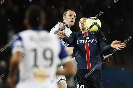 Zlatan Ibrahimovic (r) of Paris St Germain in Action Against Sebastien Squillaci of Sc Bastia During the French League 1 Soccer Match Paris Saint Germain Vs Sc Bastia at the Parc Des Princes Stadium in Paris France 08 January 2016 France Paris