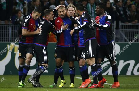 Fc Basel's Defender Walter Adrian Samuel (c) Celebrates with Team Mates After Scoring a Goal During the Uefa Europa League Round of 32 Match Between As St-etienne and Fc Basel at the Stade Geoffroy-guichard in Saint-etienne France 18 February 2016 France Saint-etienne