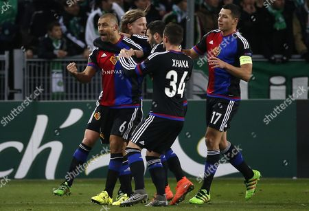 Fc Basel's Defender Walter Adrian Samuel (l) Celebrates with Team Mates After Scoring a Goal During the Uefa Europa League Round of 32 Match Between As St-etienne and Fc Basel at the Stade Geoffroy-guichard in Saint-etienne France 18 February 2016 France Saint-etienne