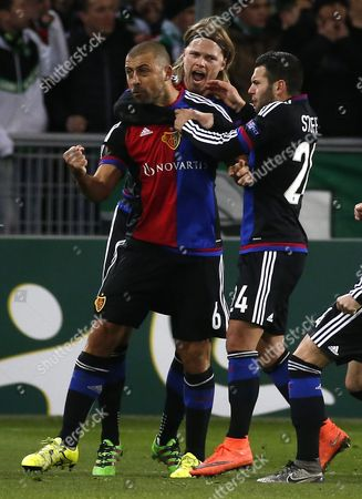 Fc Basel's Defender Walter Adrian Samuel Celebrates with Team Mates After Scoring a Goal During the Uefa Europa League Round of 32 Match Between As St-etienne and Fc Basel at the Stade Geoffroy-guichard in Saint-etienne France 18 February 2016 France Saint-etienne