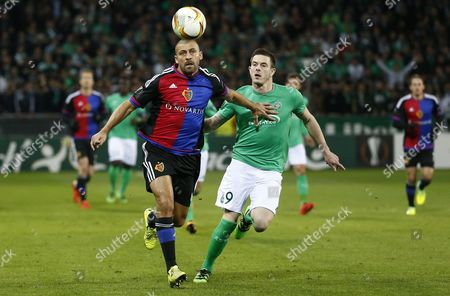 Fc Basel's Defender Walter Adrian Samuel (l) Fights For the Ball with Nolan Roux of As Saint Etienne (r) During the Uefa Europa League Round of 32 Match Between As St-etienne and Fc Basel at the Stade Geoffroy-guichard in Saint-etienne France 18 February 2016 France Saint-etienne
